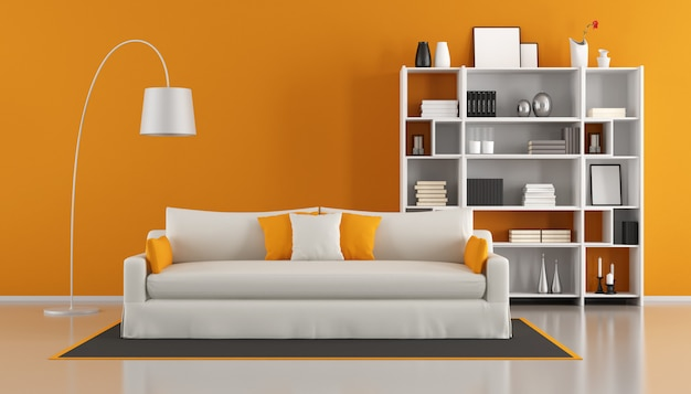 白いソファと本棚のあるオレンジ色のモダンなリビングルーム