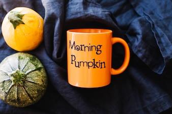 Orange mug and pumpkins
