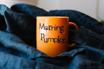 Orange mug on black cloth