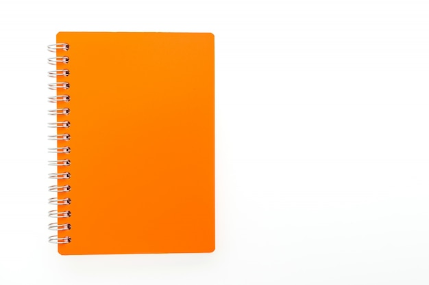 Orange notebook in a white background