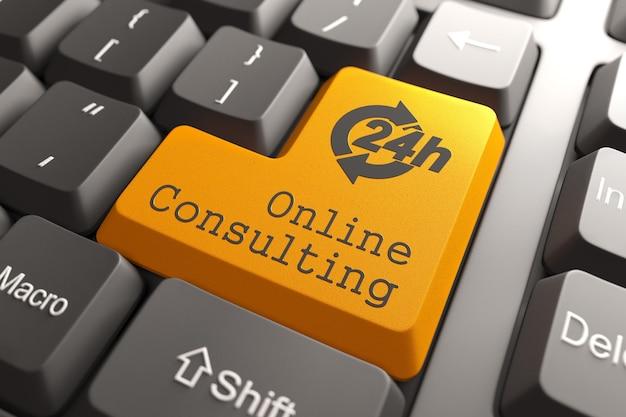 Оранжевая кнопка онлайн-консультации на клавиатуре компьютера