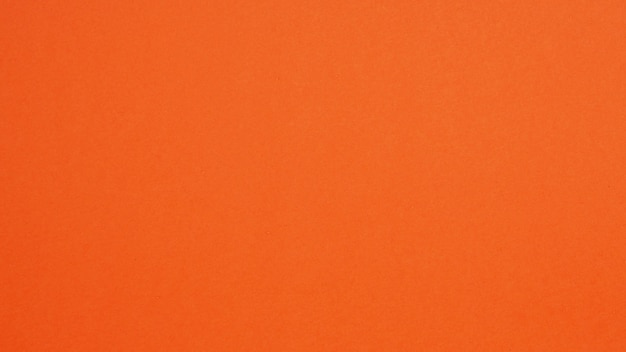 背景にオレンジ色の紙。空きスペースで人がいません。