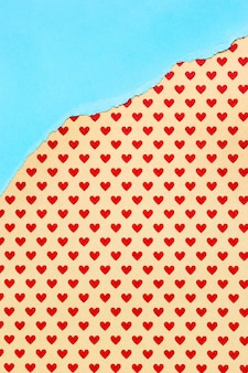Orange paper with red hearts background