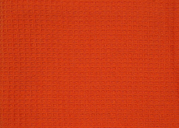 Orange patterned fabric waffle towel. top view pattern for design or backdrop.