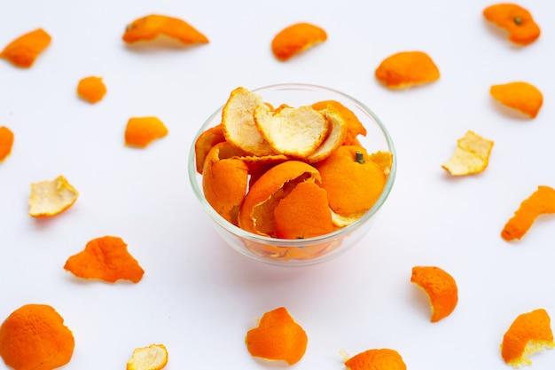 Orange peels on white surface