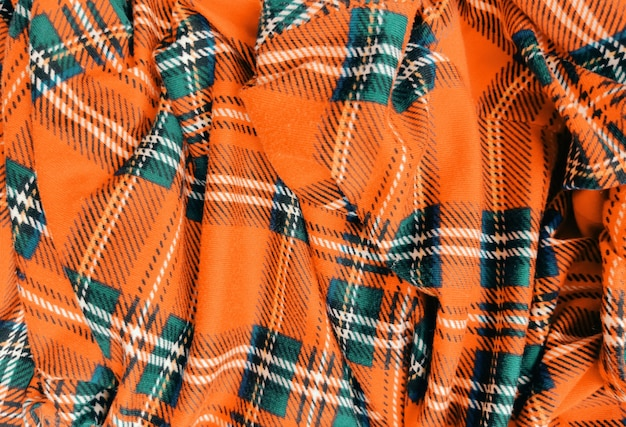 오렌지 격자 무늬 직물 구겨진 배경