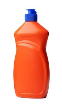 白で隔離される液体洗剤のオレンジ色のプラスチックボトル