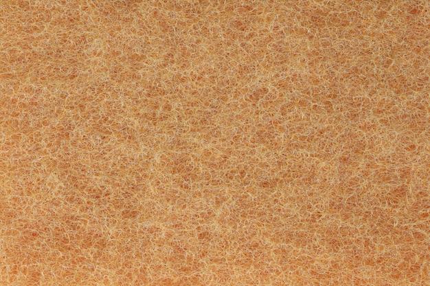 Orange plastic fibers texture background.