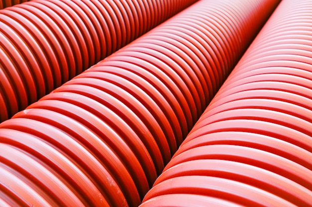 Orange plastic pipes