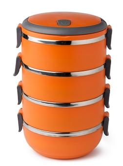 白い背景の上のオレンジ色のプラスチックティフィンコンテナー