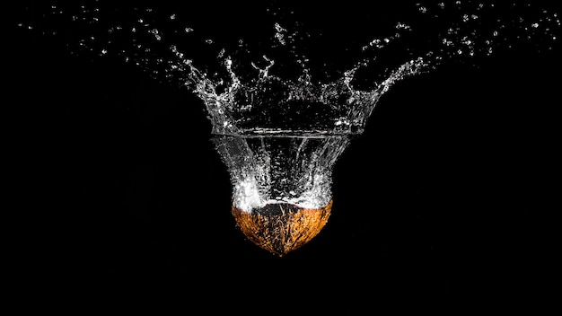 Orange plunging into the water