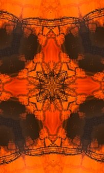 Orange polygonal kaleidoscope pattern, which consist of triangles. geometric background in origami style with gradient. triangular design for your business. vertical image.