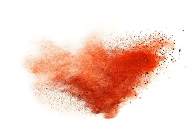 Orange powder explosion isolated on white