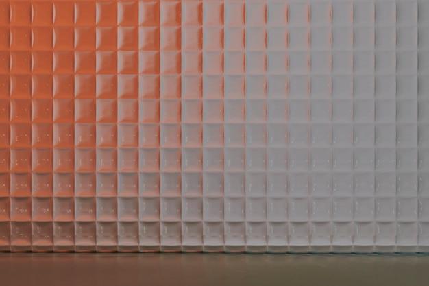 パターン化されたガラスとオレンジ色の製品の背景