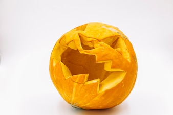 Orange pumpkin with carved scary face