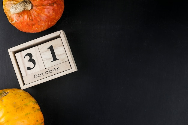 Orange pumpkins and date on wooden box