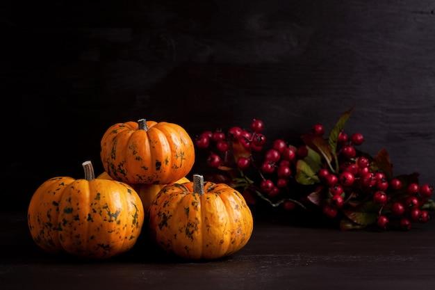 Orange pumpkins on the wooden backgound