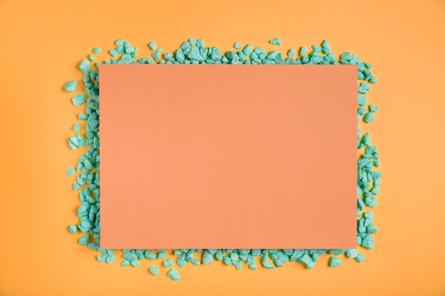 Orange rectangle mock-up with green rocks