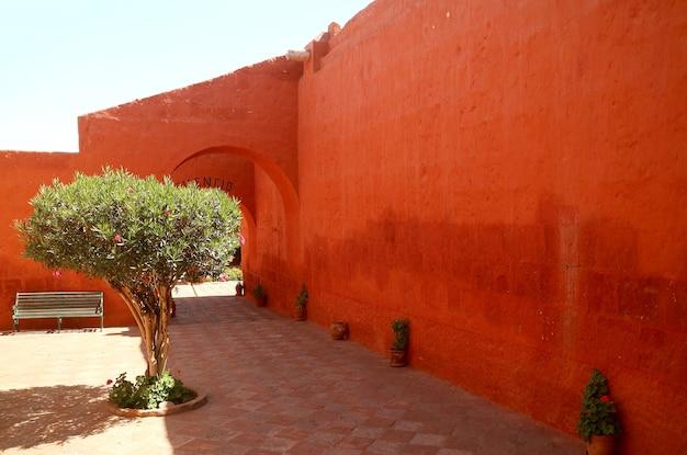Orange red colored historic buildings in convent of santa catalina de siena, arequipa, peru