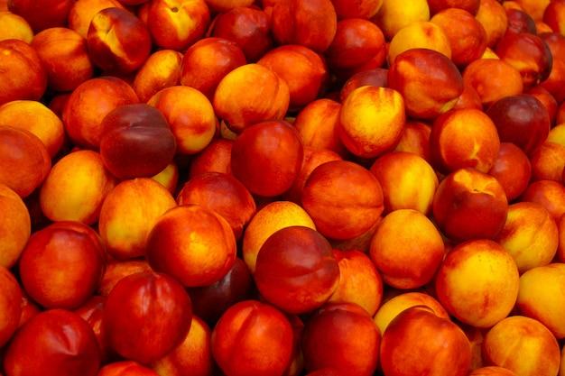 Orange and red ripe nectarines.