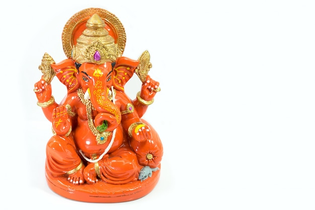 Orange resin ganesh elephant god in hindu isolated.