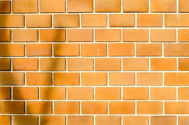 Orange ruled brick wall texture background