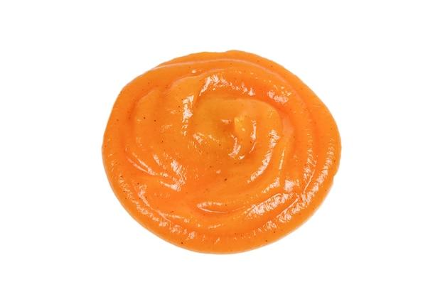 Orange sauce splashes isolated