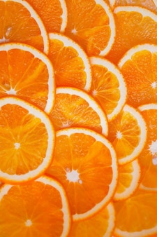 Orange sliced into circles. the background is filled with an orange