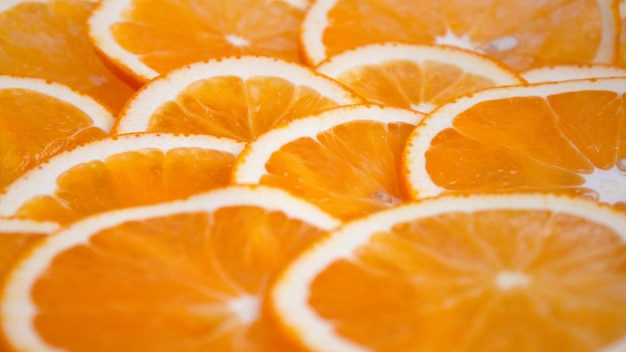 Orange sliced into circles. the background is filled with an orange.