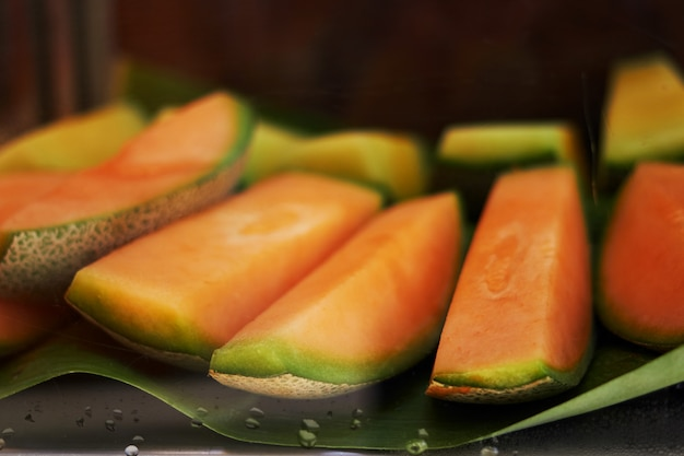 Orange sliced melon or thai melon in natural banana leaf serve