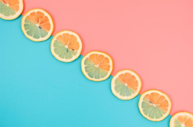 Orange slices aligned on table