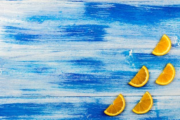 Orange slices on a blue background