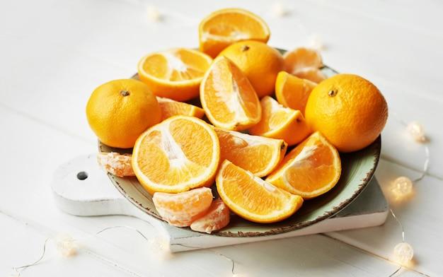 Orange slices on white wood