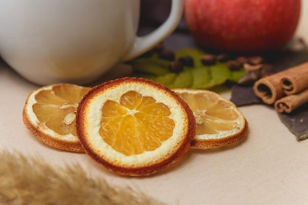 Orange slices with cinnamon sticks