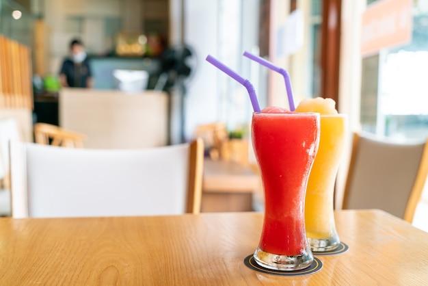 Orange smoothie and watermelon smoothie glass in cafe restaurant