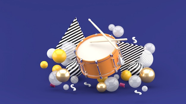 Orange snare among the colorful balls on the purple. 3d rendering.
