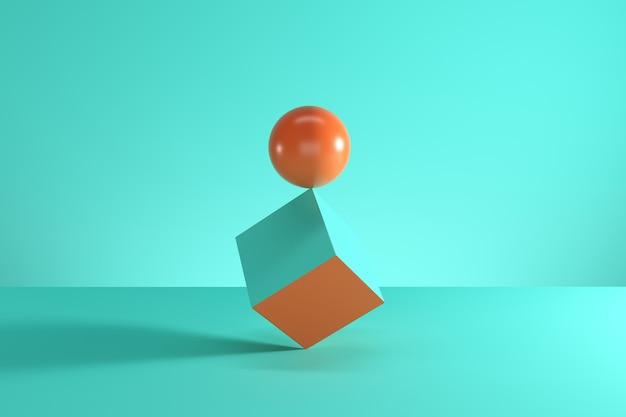 Orange sphere on the edge of blue cube isolated on blue background.