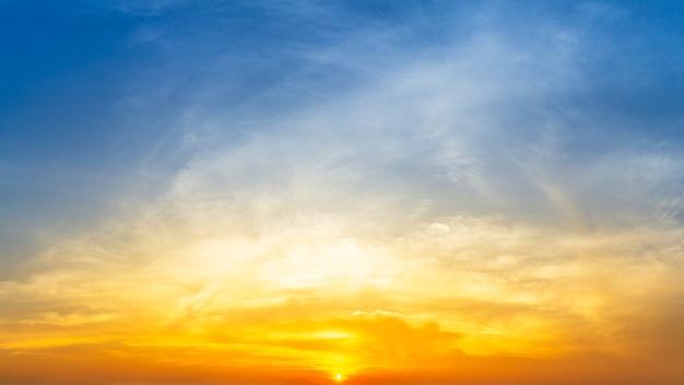 Orange sunrise and fluffy cloud sky nature background