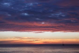Orange sunset sky with clouds. Beautiful sky.
