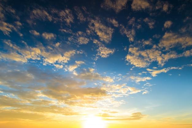 Orange sunset sky with rays of sun