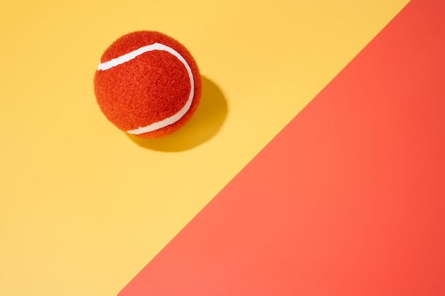 An orange tennis ball on a yellow and orange background.sport.abstract.3d illustration.copy space
