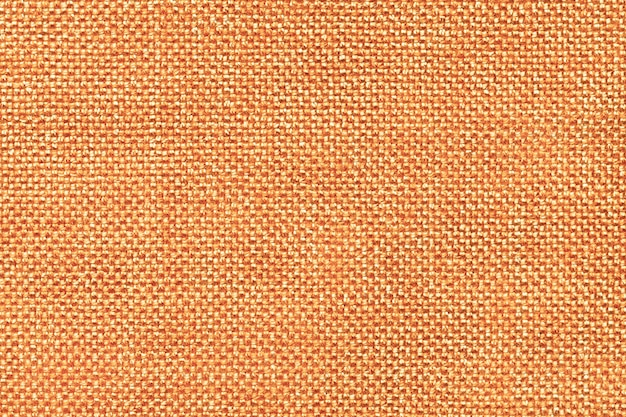 Orange textile background closeup. structure of the fabric macro