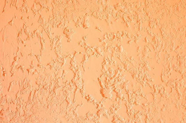 Orange textured plastered wall. fresh otvetka in commercial premises, designer renovation in the house