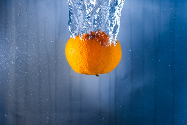 Orange thrown into the water