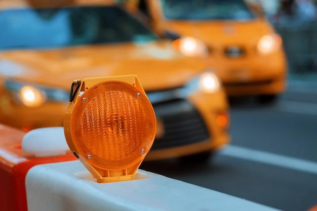 Orange traffic barrier barrels to detour traffic around construction zone shallow depth