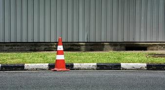 Orange traffic cone on asphalt road