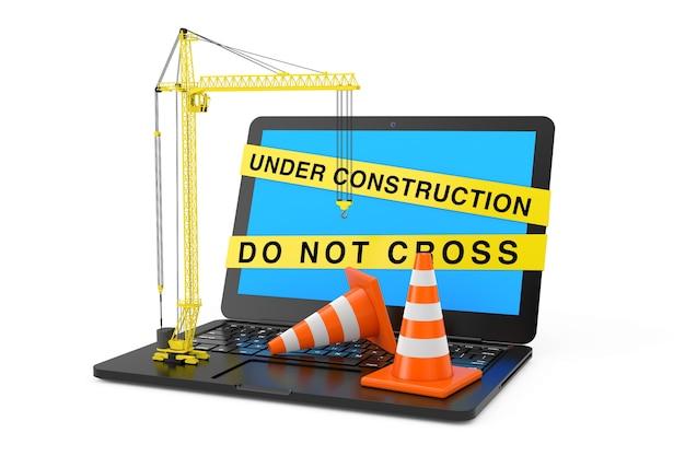 Оранжевые конусы движения и желтый башенный кран над ноутбуком с строящейся лентой на белом фоне. 3d рендеринг