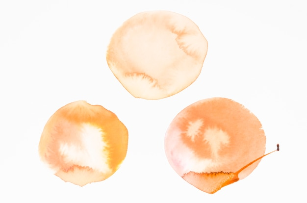 An orange watercolor blots design texture on white background