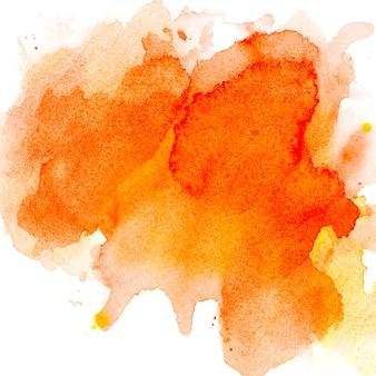 紙の上のオレンジ色の水彩画。