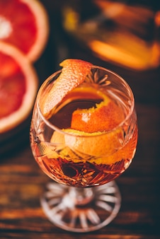 Orange whiskey sour cocktail with bourbon, blood orange juice and simple syrup